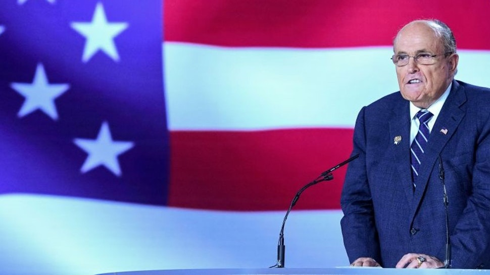"""Former Mayor of New York City Rudy Giuliani gestures as he speaks during a conference """"120 Years of Struggle for Freedom Iran"""" at Ashraf-3 camp, which is a base for the People's Mojahedin Organization of Iran (MEK) in Albanian town of Manza, on July 13, 2019."""