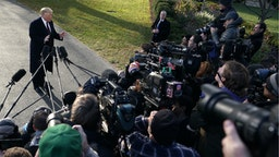 President Donald Trump speaks to members of the media prior to his departure from the White House November 20, 2018 in Washington, DC.