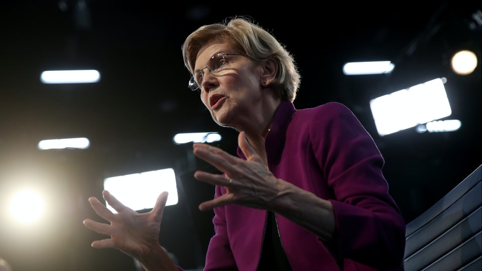 Sen. Elizabeth Warren (D-MA) speaks to the media in the spin room following the first night of the Democratic presidential debate on June 26, 2019 in Miami, Florida.