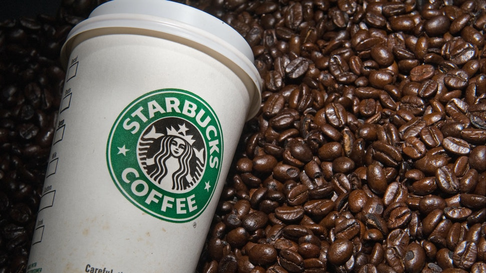 A Starbucks coffee cup and beans are seen in this photo taken August 12, 2009 in Washington, DC.