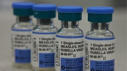 In this photo illustration, vials of measles, mumps and rubella vaccine are displayed on a counter at a Walgreens Pharmacy on January 26, 2015 in Mill Valley, California.