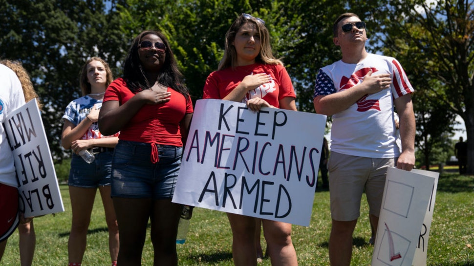 People sing the national anthem during the March For Our Rights rally, promoting Second Amendment Rights and the safety of students in schools outside the U.S. Capitol on July 7, 2018 in Washington, DC.