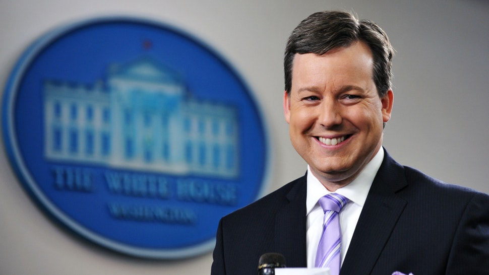 Fox White House correspondent Ed Henry prepares to do a stand-up December 8, 2011 in the Brady Briefing Room of the White House in Washington, DC.