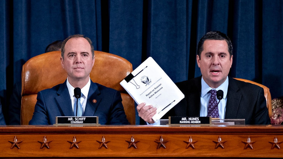 Representative Devin Nunes, a Republican from California and ranking member of the House Intelligence Committee, right, speaks as Representative Adam Schiff, a Democrat from California and chairman of the House Intelligence Committee, listens during an impeachment inquiry hearingon Capitol Hill November 21, 2019 in Washington, DC. The committee heard testimony during the fifth day of open hearings in the impeachment inquiry against U.S. President Donald Trump, whom House Democrats say held back U.S. military aid for Ukraine while demanding it investigate his political rivals. (Photo by Andrew Harrer-Pool/Getty Images)