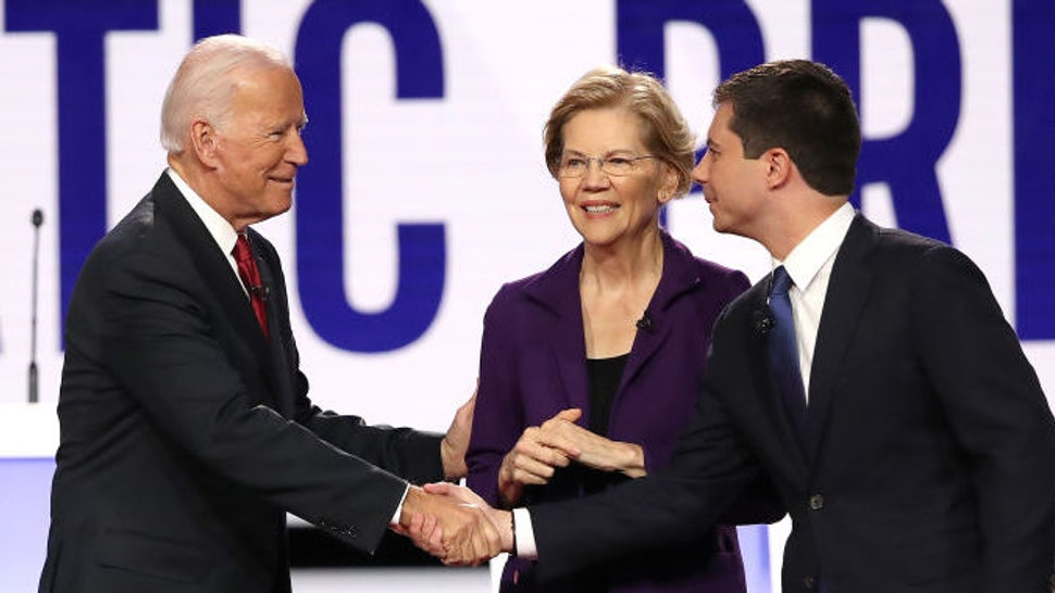 Democratic presidential candidates (L-R) Sen. Bernie Sanders (I-VT), former Vice President Joe Biden, Sen. Elizabeth Warren (D-MA) and South Bend, Indiana Mayor Pete Buttigieg enter the stage before the Democratic Presidential Debate at Otterbein University on October 15, 2019 in Westerville, Ohio. A record 12 presidential hopefuls are participating in the debate hosted by CNN and The New York Times. (Photo by Win McNamee/Getty Images)