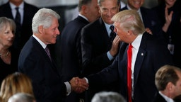 President Donald Trump greets former President Bill Clinton at the Inaugural Luncheon in the US Capitol January 20, 2017 in Washington, DC. President Trump will attend the luncheon along with other dignitaries. (Photo by Aaron P. Bernstein/Getty Images)