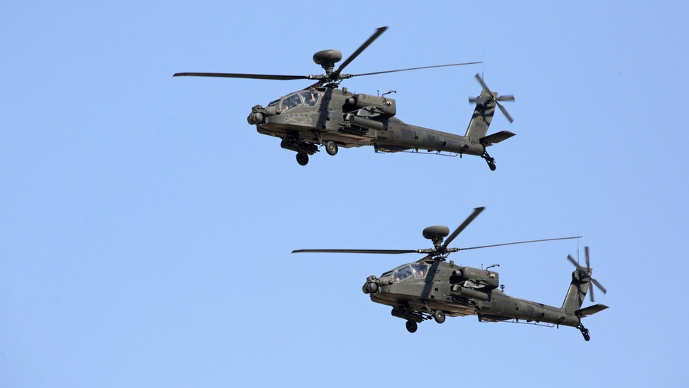 DUBAI, UNITED ARAB EMIRATES - NOVEMBER 17, 2019: Boeing AH-64 Apache attack helicopters perform at the 2019 Dubai Airshow.