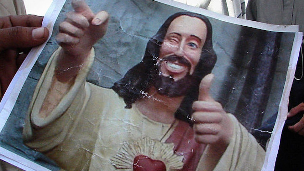 """A picture of """"Buddy Jesus"""" from the 1999 film """"Dogma."""" (Photo credit should read WISSAM AL-OKAILI/AFP via Getty Images)"""