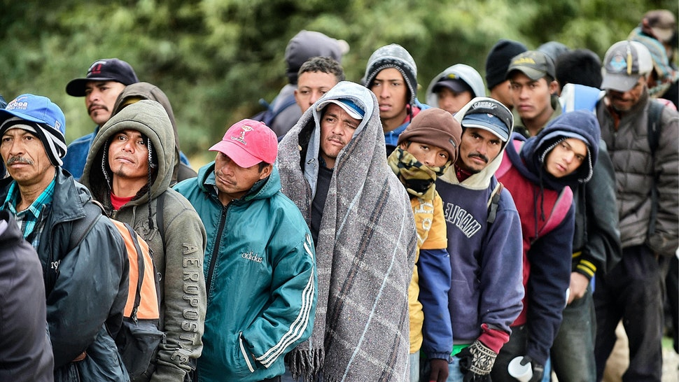 Migrants wait to receive food donated by people from the Community Center for Migrant Assistance in the community of Caborca in Sonora state, Mexico, on January 13, 2017.