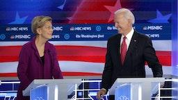 Sen. Elizabeth Warren (D-MA) and former Vice President Joe Biden look at each other during the Democratic Presidential Debate at Tyler Perry Studios November 20, 2019 in Atlanta, Georgia.