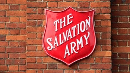 Salvation Army sign on brick wall, Andover, Hampshire, England.