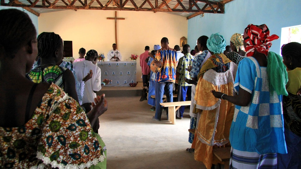 Burkina-Faso: church in a village with faithful families here for the prayer of the district of Toleha, November 2008