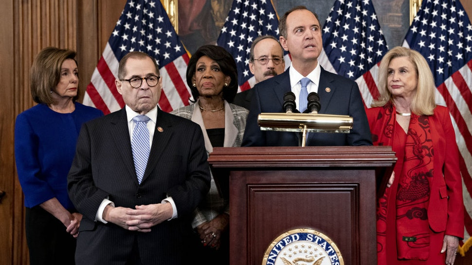 Representative Adam Schiff, a Democrat from California and chairman of the House Intelligence Committee, second right, speaks as U.S. House Speaker Nancy Pelosi, a Democrat from California, from left, Representative Jerry Nadler, a Democrat from New York and chairman of the House Judiciary Committee, Representative Maxine Waters, a Democrat from California and chairwoman of the House Financial Services Committee, Representative Eliot Engel, a Democrat from New York and chairman of the House Foreign Affairs Committee, and Representative Carolyn Maloney, a Democrat from New York and chairwoman of the House Oversight Committee, listen during a news conference announcing the next steps in the impeachment inquiry at the U.S. Capitol in Washington, D.C., U.S., on Tuesday, Dec. 10, 2019. House Democrats unveiled two articles of impeachment against President Donald Trump, one on abuse of power and the other involving obstruction of Congress. Photographer: Andrew Harrer/Bloomberg