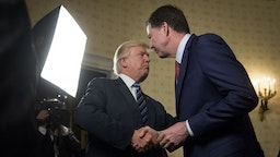 President Donald Trump, left, shakes hands with James Comey, director of the Federal Bureau of Investigation (FBI), during an Inaugural Law Enforcement Officers and First Responders Reception in the Blue Room of the White House in Washington, D.C., U.S., on Sunday, Jan. 22, 2017. The one year anniversary of U.S. President Donald Trump's inauguration falls on Saturday, January 20, 2018. Our editors select the best archive images looking back over Trump's first year in office. Photographer: Andrew Harrer/Bloomberg