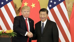 U.S. President Donald Trump, left, and Xi Jinping, China's president, shake hands during a news conference at the Great Hall of the People in Beijing, China, on Thursday, Nov. 9, 2017. Donald Trump and Vladimir Putin will meet in Helsinki, Finland, on July 16 for their first bilateral summit as the leaders seek to reverse a downward spiral in relations that has been exacerbated by findings that Russia meddled in U.S. elections. Our editors select a set of archive images of U.S. President Donald Trump ahead of the summit meeting. Photographer: Qilai Shen/Bloomberg