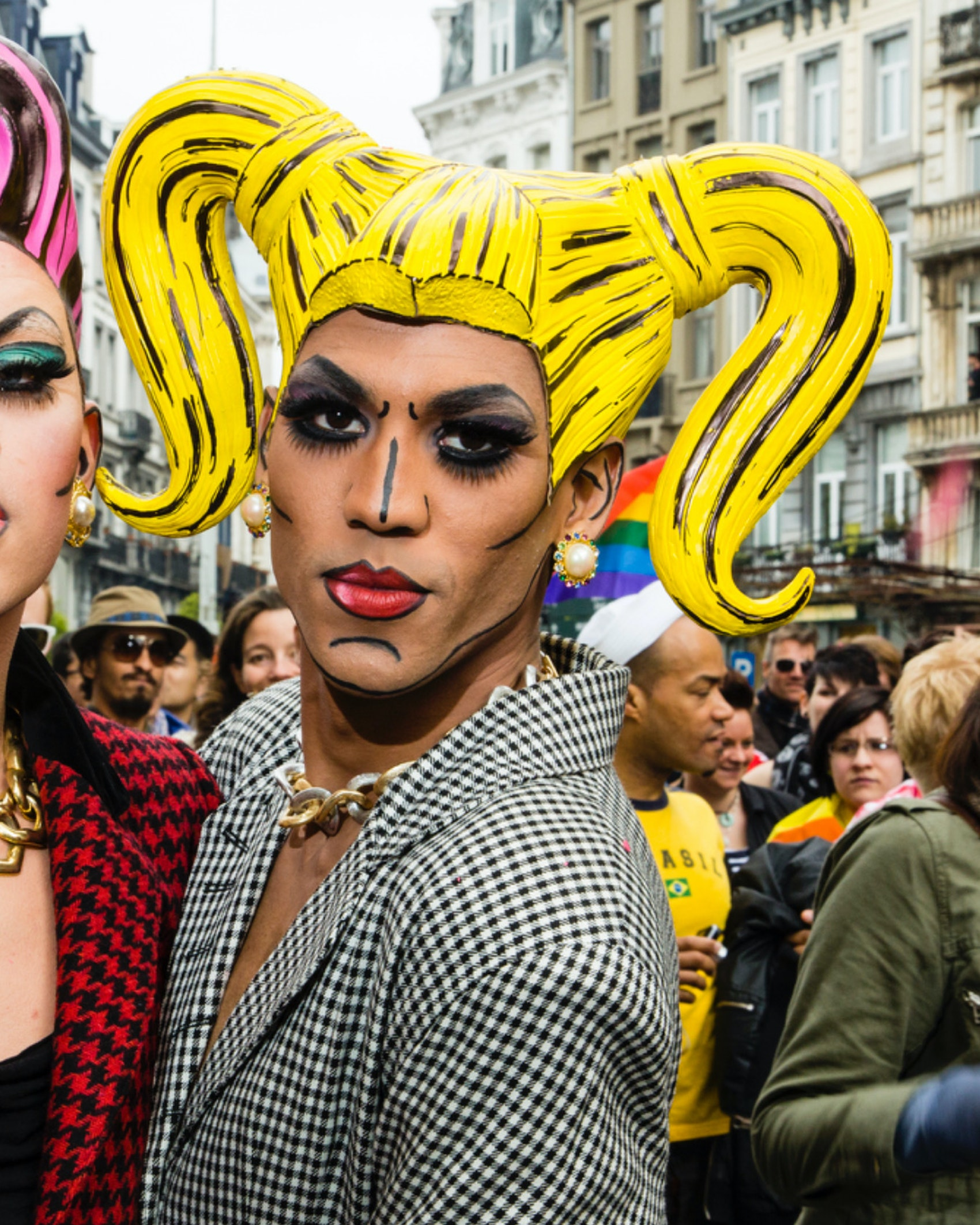 Two dressed up gay men pose in the streets of Brussels. About 80,000 participants at the Belgian Pride Parade to celebrate the LGBT (Lesbian, gay, bisexual, transgender) community and demand equal rights.