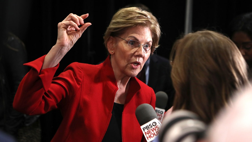 DECEMBER 19: Sen. Elizabeth Warren (D-MA) speaks with the media after the Democratic presidential primary debate at Loyola Marymount University on December 19, 2019 in Los Angeles, California. Seven candidates out of the crowded field qualified for the 6th and last Democratic presidential primary debate of 2019 hosted by PBS NewsHour and Politico.