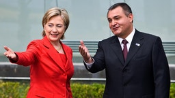 US Secretary of State Hillary Clinton (L) gestures next to the Secretary of the Federal Public Security Genaro Garcia Luna upon her arrival to the Center Command of the Mexican Federal Police in Mexico City, on March 26, 2009. Clinton is in Mexico for a two-day visit.