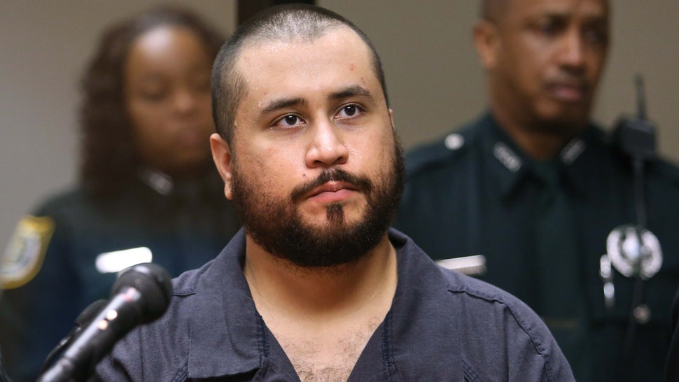 SANFORD, FL - NOVEMBER 19: George Zimmerman, the acquitted shooter in the death of Trayvon Martin, faces a Seminole circuit judge during a first-appearance hearing on charges including aggravated assault stemming from a fight with his girlfriend November 19, 2013 in Sanford, Florida. Zimmerman, 30, was arrested after police responded to a domestic disturbance call at a house. He was acquitted in July of all charges in the shooting death of unarmed, black teenager, Trayvon Martin.