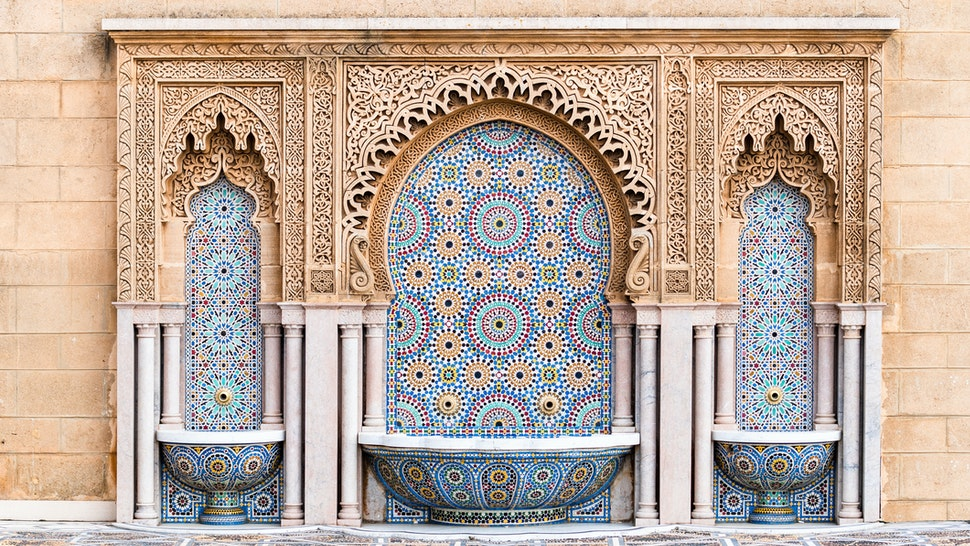 Water fountain with zelige intricate pattern of tiles in classic islamic style on the outside of Mosque Hassan in Rabat, Morocco