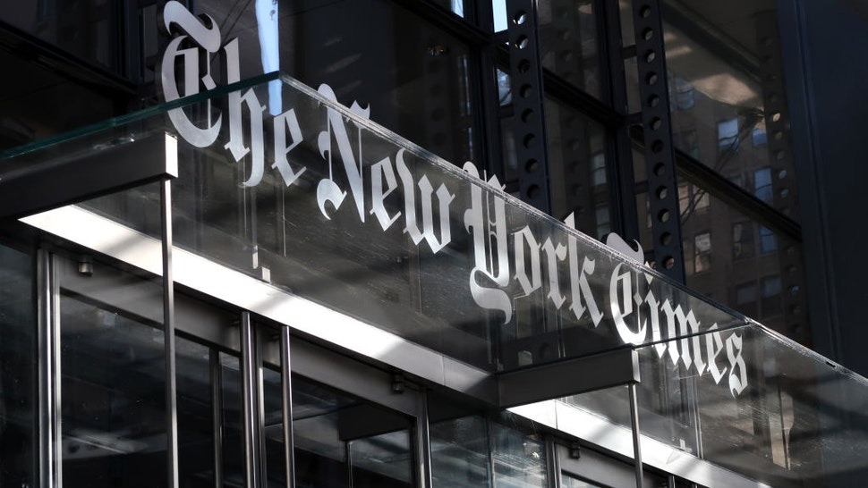 NEW YORK, NY - OCTOBER 23: The corporate logo of the New York Times hangs above the front door of their headquarters on October 23, 2018 in New York City.