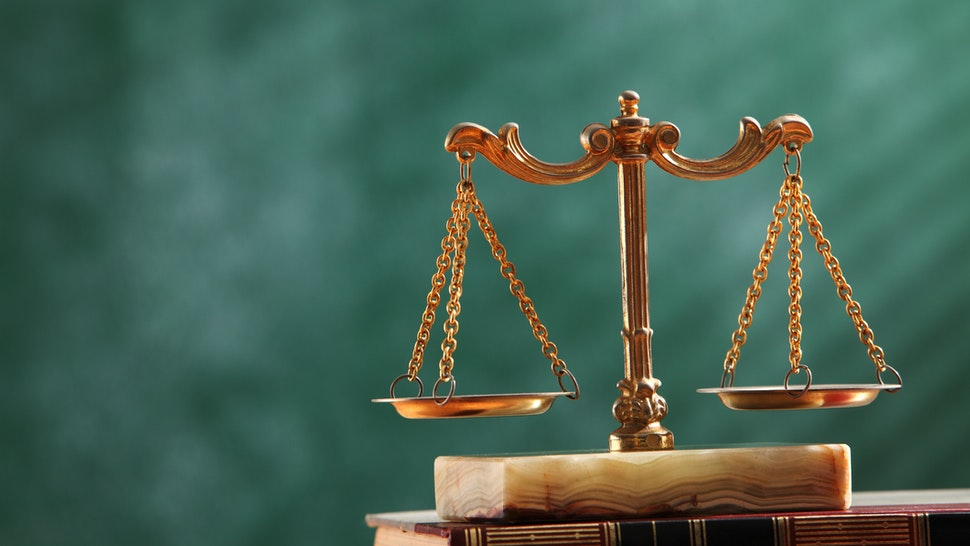 Close-Up Of Scales Of Justice - stock photo