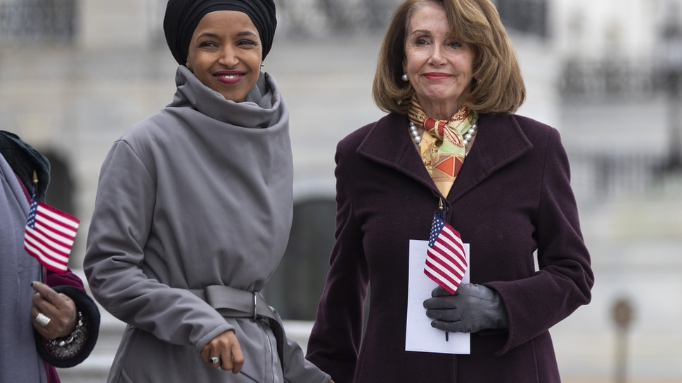 U.S. House Speaker Nancy Pelosi, a Democrat from California, right, and Representative Ilhan Omar, a Democrat from Minnesota, smile during a news conference in Washington, D.C., U.S., on Friday, March 8, 2019. House Democrats are set to approve H.R. 1, a far-reaching elections and ethics bill that would change the way congressional elections are funded, impose new voter-access mandates on states, require groups to publicize donors and force disclosure of presidential candidates' tax returns. Photographer: Alex Edelman/Bloomberg via Getty Images