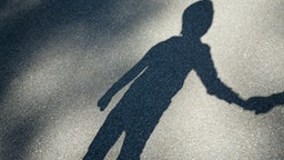 Shadow of a boy - stock photo