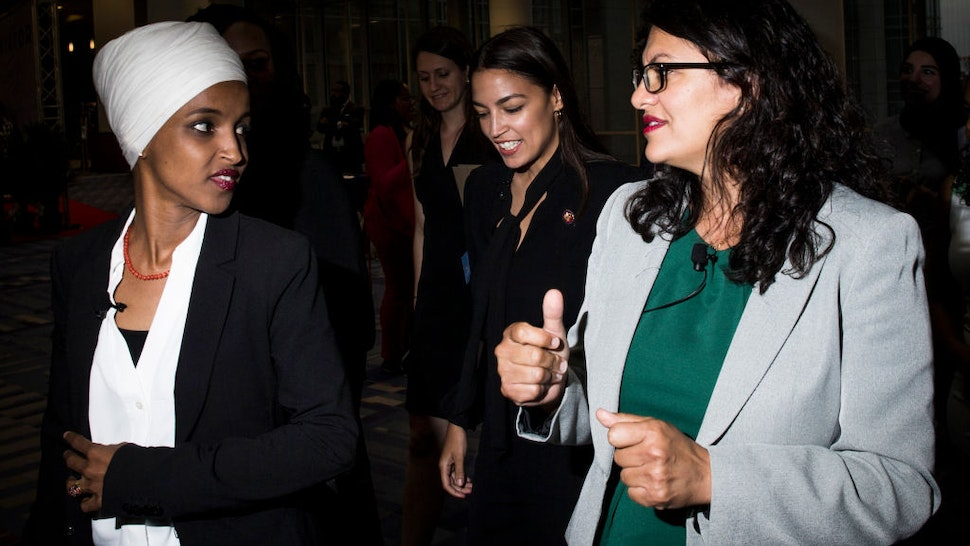 p. Ilhan Omar (D-MN), Rep. Alexandria Ocasio-Cortez (D-NY) and Rep. Rashida Tlaib (D-MI) arrive before participating during a town hall hosted by the NAACP on September 11, 2019 in Washington, DC.