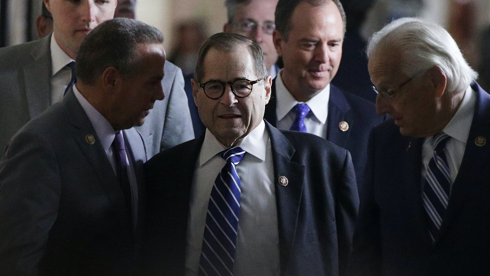 WASHINGTON, DC - SEPTEMBER 25: U.S. Rep. Jerry Nadler (D-NY), chairman of House Judiciary Committee, arrives with Rep. Bill Pascrell (D-NJ), Rep. David Cicilline (D-RI) and Rep. Adam Schiff (D-CA), chairman of House Intelligence Committee, at a House Democratic Caucus meeting at the U.S. Capitol September 25, 2019 in Washington, DC. House Democrats met to discuss their agenda one day after Speaker of the House Rep. Nancy Pelosi has announced a formal impeachment inquiry into President Donald Trump. (Photo by Alex Wong/Getty Images)