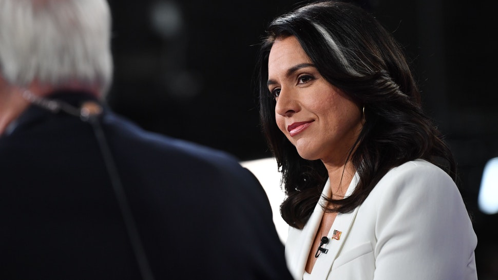 Democratic presidential hopeful Representative for Hawaii Tulsi Gabbard speaks to the press in the Spin Room following the fifth Democratic primary debate of the 2020 presidential campaign season co-hosted by MSNBC and The Washington Post at Tyler Perry Studios in Atlanta, Georgia on November 20, 2019. (Photo by Nicholas Kamm / AFP) (Photo by NICHOLAS KAMM/AFP via Getty Images)