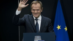 Outgoing European Council President Donald Tusk waves during the handover ceremony between Tusk and his successor, at the European headquarters in Brussels, on November 29, 2019.