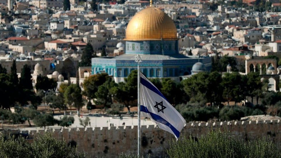 A picture taken from the Mount of Olives shows an Israeli flag fluttring as Jerusalem's Old City and its Dome of the Rock mosque in the centre on November 29, 2019