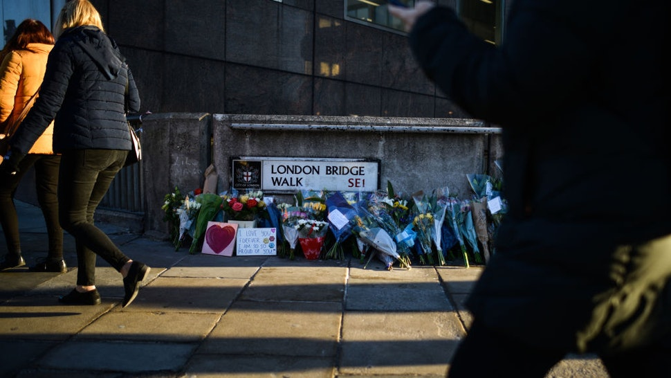 Floral tributes are left for Jack Merritt and Saskia Jones, who were killed in a terror attack, on December 2, 2019 in London, England. Usman Khan, a 28 year old former prisoner convicted of terrorism offences, killed two people in Fishmongers' Hall at the North end of London Bridge on Friday, November 29, before continuing his attack on the bridge. Mr Khan was restrained and disarmed by members of the public before being shot by armed police.