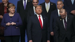HERTFORD, ENGLAND - DECEMBER 04: Chancellor of Germany Angela Merkel and US President Donald Trump stand onstage during the annual NATO heads of government summit on December 4, 2019 in Watford, England. France and the UK signed the Treaty of Dunkirk in 1947 in the aftermath of WW2 cementing a mutual alliance in the event of an attack by Germany or the Soviet Union. The Benelux countries joined the Treaty and in April 1949 expanded further to include North America and Canada followed by Portugal, Italy, Norway, Denmark and Iceland. This new military alliance became the North Atlantic Treaty Organisation (NATO). The organisation grew with Greece and Turkey becoming members and a re-armed West Germany was permitted in 1955. This encouraged the creation of the Soviet-led Warsaw Pact delineating the two sides of the Cold War. This year marks the 70th anniversary of NATO. (Photo by Steve Parsons-WPA Pool/Getty Images)