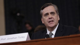 Jonathan Turley, J.B. and Maurice C. Shapiro professor of public interest law at the George Washington University Law School, delivers an opening statement during a House Judiciary Committee impeachment inquiry hearing in Washington, D.C., U.S., on Wednesday, Dec. 4, 2019. The impeachment of President Donald Trump moves to one of the most polarized committees in Congress where Republicans known for their combativeness will pose a test of the judiciary chairman's ability to keep the proceedings under control.