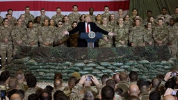 In this file photo taken on November 28, 2019, US President Donald Trump speaks to the troops during a surprise Thanksgiving day visit at Bagram Air Field in Afghanistan.