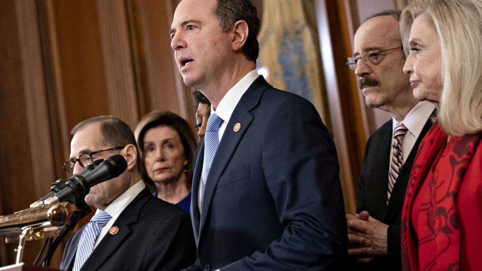 Representative Adam Schiff, a Democrat from California and chairman of the House Intelligence Committee, center, speaks as Representative Jerry Nadler, a Democrat from New York and chairman of the House Judiciary Committee, from left, U.S. House Speaker Nancy Pelosi, a Democrat from California, Representative Eliot Engel, a Democrat from New York and chairman of the House Foreign Affairs Committee, and Representative Carolyn Maloney, a Democrat from New York and chairwoman of the House Oversight Committee, listen during a news conference announcing the next steps in the impeachment inquiry at the U.S. Capitol in Washington, D.C., U.S., on Tuesday, Dec. 10, 2019. House Democrats unveiled two articles of impeachment against President Donald Trump, one on abuse of power and the other involving obstruction of Congress.