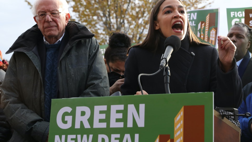 WASHINGTON, DC - NOVEMBER 14: Democratic presidential candidate Sen. Bernie Sanders (I-VT) (L) and Rep. Alexandria Ocasio-Cortez (D-NY) hold a news conference to introduce legislation to transform public housing as part of their Green New Deal proposal outside the U.S. Capitol November 14, 2019 in Washington, DC. The liberal legislators invited affordable housing advocates and climate change activists to join them for the announcement. (Photo by Chip Somodevilla/Getty Images)