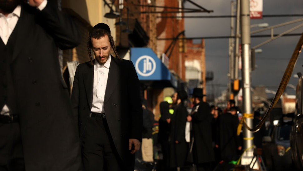 Members of the Jewish community gather around the JC Kosher Supermarket on December 11, 2019 in Jersey City, New Jersey.