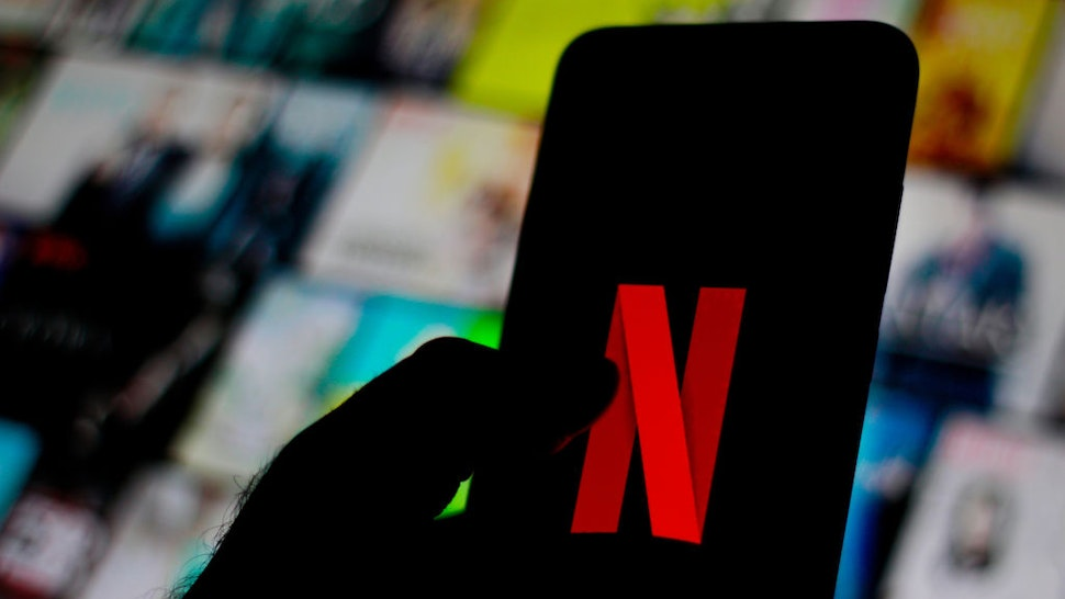 In this photo illustration the Netflix logo is seen displayed on a smartphone.