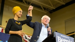 Democratic presidential candidate, Sen. Bernie Sanders (I-VT), and Representative Ilhan Omar (D-MN) on stage during Sanders' event at Nashua Community College on December 13, 2019 in Nashua, New Hampshire.