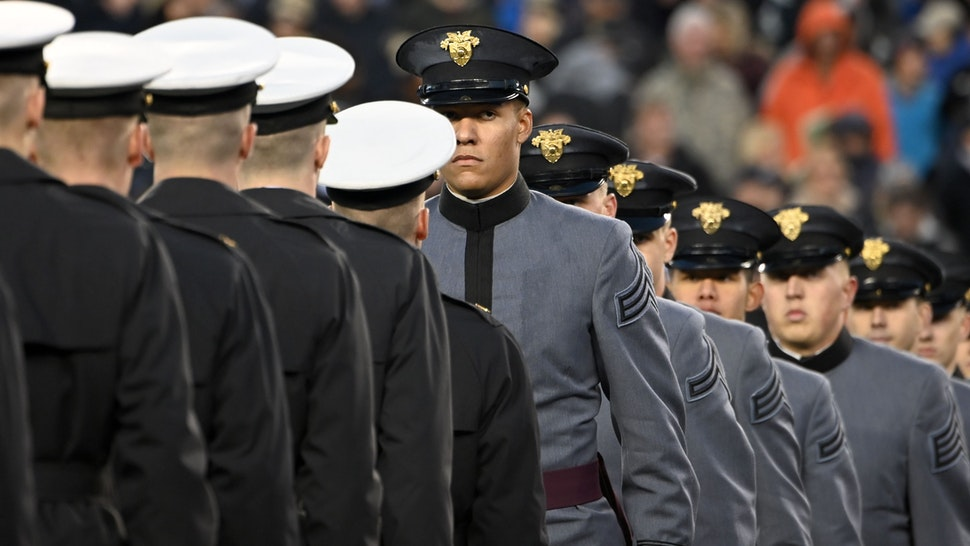 Army and Navy members meet half way as US President Donald Trump attends the Army-Navy football game in Philadelphia, Pennsylvania on December 14, 2019. (Photo by Andrew Caballero-Reynolds / AFP) (Photo by ANDREW CABALLERO-REYNOLDS/AFP via Getty Images)