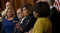 U.S. House Speaker Nancy Pelosi, a Democrat from California, center, speaks during a news conference after the House voted on articles of impeachment against President Donald Trump at the U.S. Capitol in Washington, D.C., U.S., on Wednesday, Dec. 18, 2019.