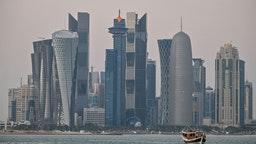 A general view taken on December 20, 2019 shows boats moored in front of the skyline of the Qatari capital, Doha.