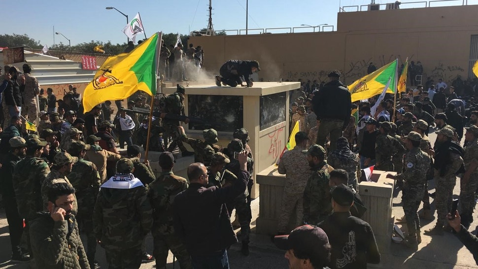 DECEMBER 31: Outraged Iraqi protesters try to storm the U.S. Embassy in Baghdad, protesting Washington's attacks on armed battalions belong to Iranian-backed Hashd al-Shaabi forces on December 31, 2019. At least 25 people were killed in weekend U.S. airstrikes on positions of Kataib Hezbollah, an Iranian-backed militia group, in Iraq and Syria. Hundreds of Iraqi protesters gathered early Tuesday near the embassy to show their anger at the U.S. move.