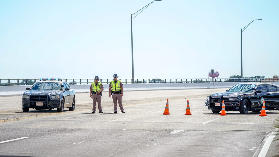 Florida State Troopers block traffic over the Bayou Grande Bridge leading to the Pensacola Naval Air Station following a shooting on December 06, 2019 in Pensacola, Florida. The second shooting on a U.S. Naval Base in a week has left three dead plus the suspect and seven people wounded.