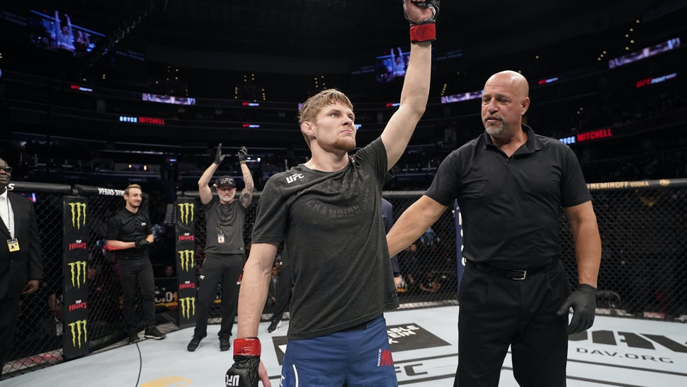 WASHINGTON, DC - DECEMBER 07: Bryce Mitchell celebrates his submission victory over Matt Sayles in their featherweight bout during the UFC Fight Night event at Capital One Arena on December 07, 2019 in Washington, DC. (Photo by Jeff Bottari/Zuffa LLC via Getty Images)