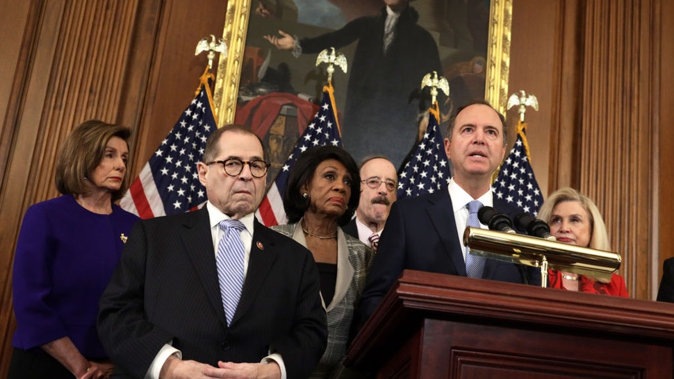 WASHINGTON, DC - DECEMBER 10: Chairman of House Intelligence Committee Rep. Adam Schiff (D-CA) (2nd-R) speaks as (L-R) Speaker of the House Rep. Nancy Pelosi (D-CA), Chairman of House Judiciary Committee Rep. Jerry Nadler (D-NY), Chairwoman of House Financial Services Committee Rep. Maxine Waters (D-CA), Chairman of House Foreign Affairs Committee Rep. Eliot Engel (D-NY) and Chairwoman of House Oversight and Reform Committee Rep. Carolyn Maloney (D-NY) listen during a news conference at the U.S. Capitol December 10, 2019 in Washington, DC. Chairman Nadler announced that the House Judiciary Committee is introducing two articles on abuse of power and obstruction of Congress for the next steps in the House impeachment inquiry against President Donald Trump.