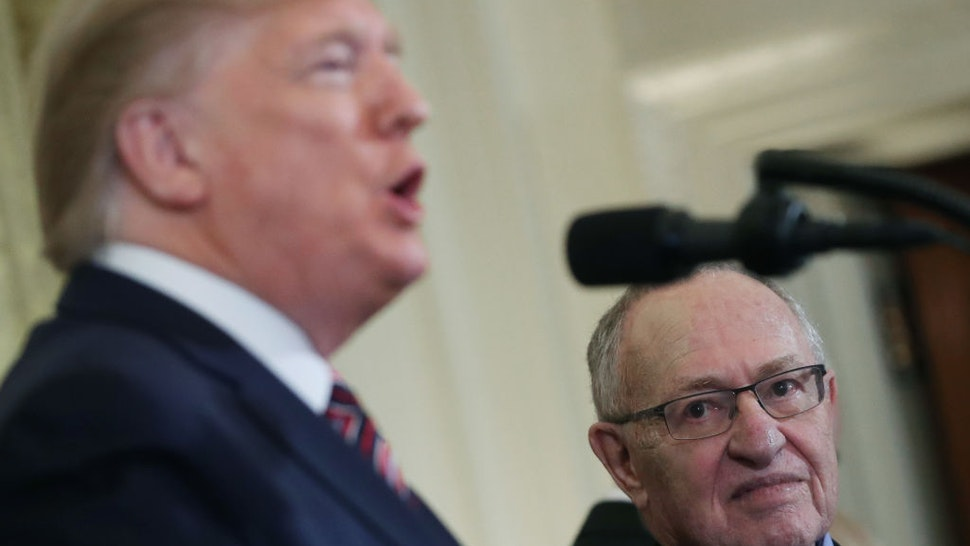 Professor Alan Dershowitz listens to U.S. President Donald Trump speak during a Hanukkah Reception in the East Room of the White House on December 11, 2019 in Washington, DC.